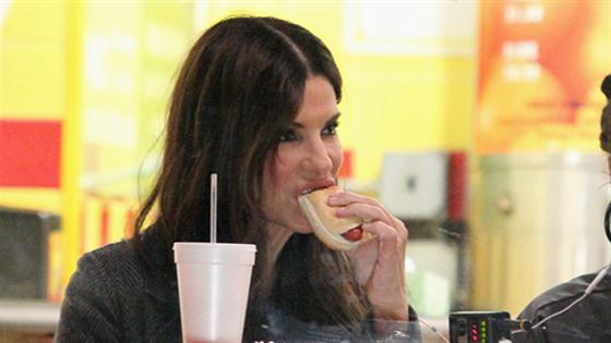Sandra Bullock and Rihanna Chow Down on Hot Dogs