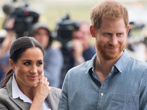 Meghan Markle Sweetly Holds Prince Harry's Umbrella