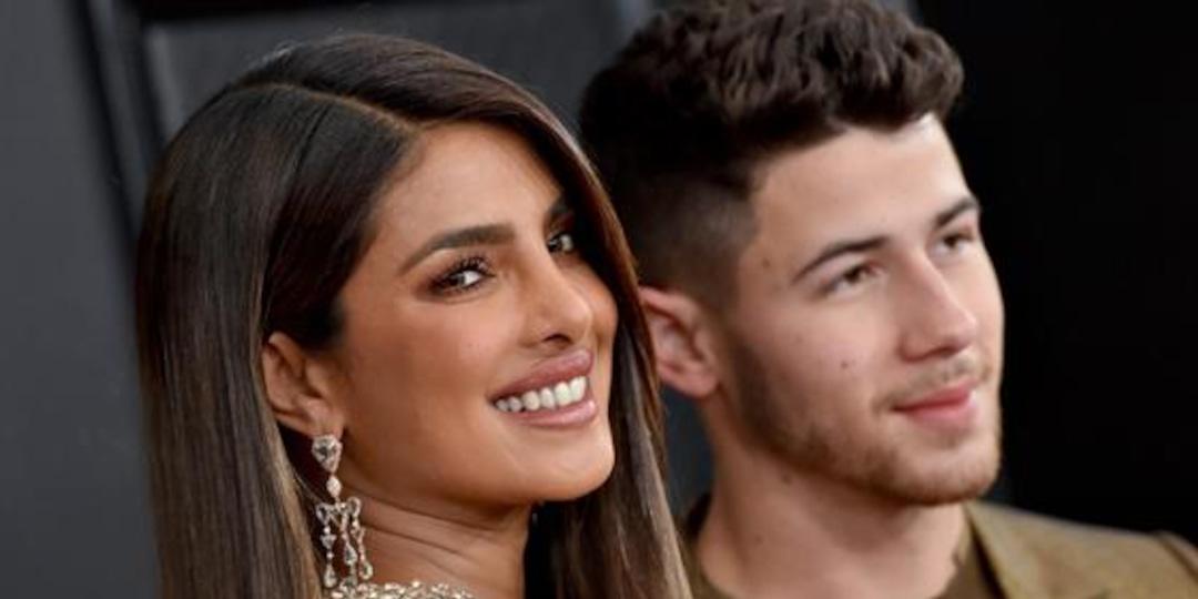 Nick Jonas Takes a Bite of Priyanka Chopra's Booty in Cheeky Pic - E! Online.jpg