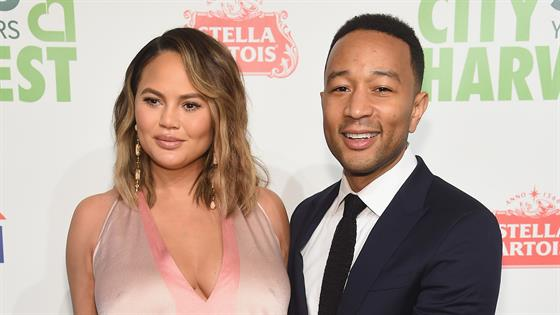 Chrissy Teigen teases John Legend by sporting adorable 'Sexiest Man Alive' onesie